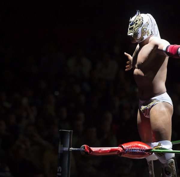 The mexican wrestling fighter Dragon Lee, stands on a corner looking to the public during a night match at the Arena Mexico in Mexico city, Mexico on  Friday, March 4, 2016. Photographer: Susana Gonzalez/Bloomberg